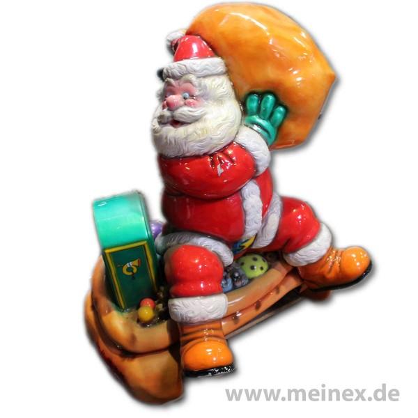 Dekorationsfigur - Weihnachtsmann auf Geschenkesack - gebraucht
