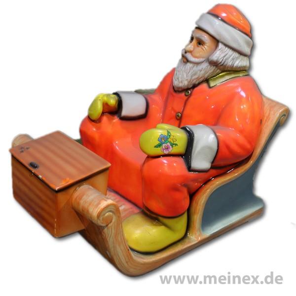 Dekorationsfigur - Weihnachtsmann auf Schlitten - Blume - gebraucht